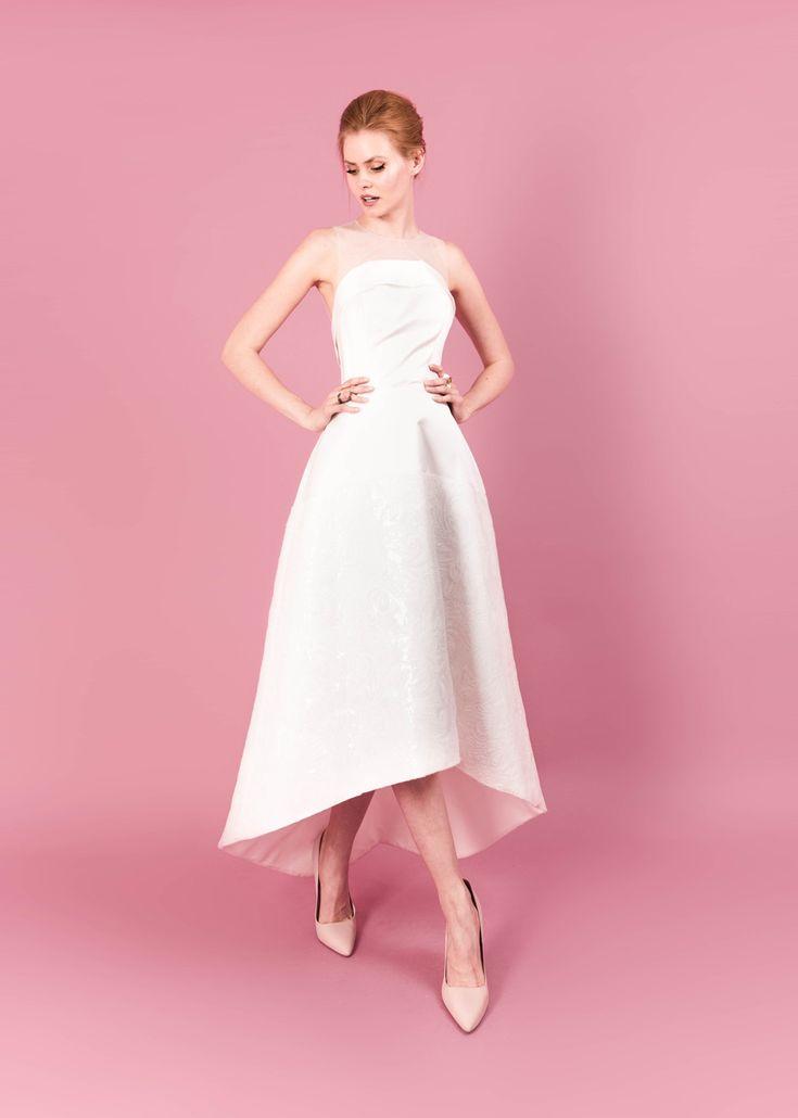Modern wedding dress for the contemporary bride. Rachel dress. Silk duchess dress with flower sequin tulle skirt and tulle neckline.