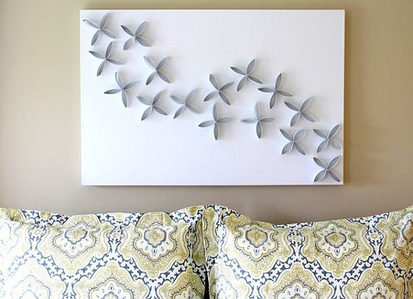 Toilet paper roll art...save toilet paper or paper towel rolls then cut and arrange on a canvas in whatever pattern you come up with.  Paint the color of your choice.  Easy and cheap!