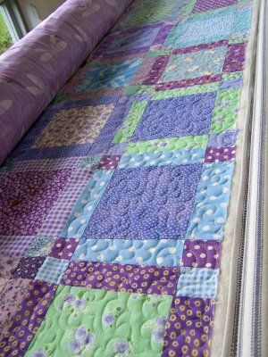 love the simple pattern and the color combination in this quilt...very pretty, very effective, It would make a pretty baby quilt.