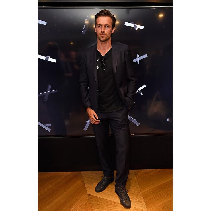 Dynamic style from @andrewcooperx wearing #ASTONMARTINxHOGAN limited edition Olympia #sneakers at #LFW event