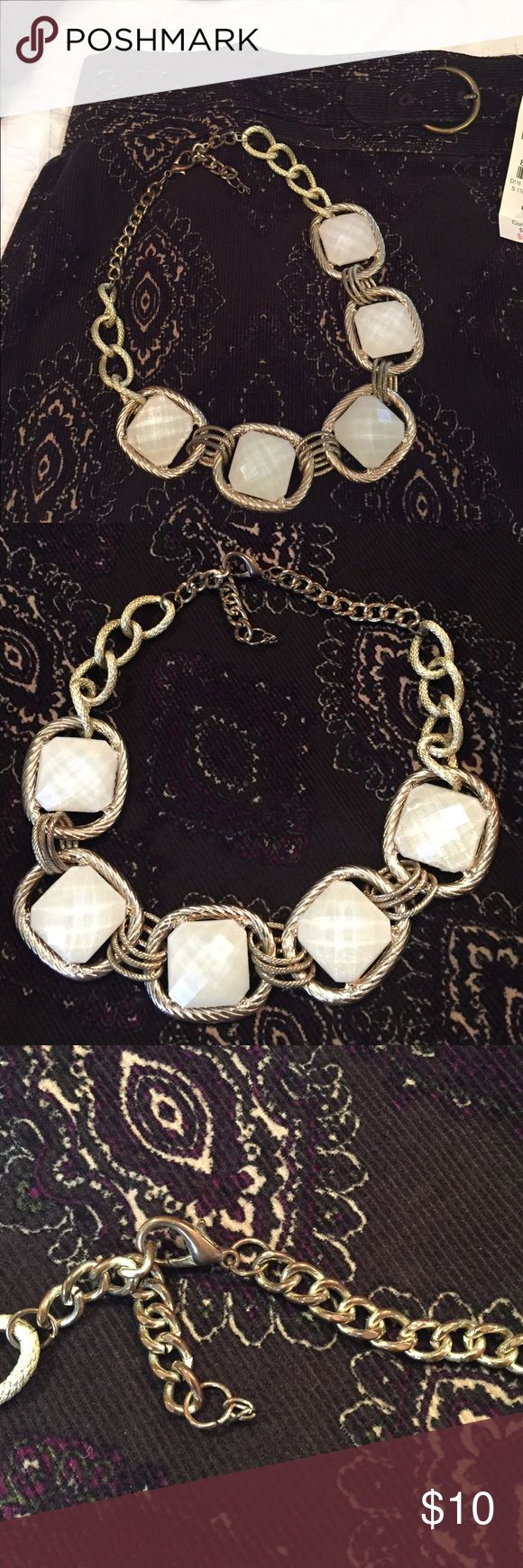 Gold and creamy white statement necklace Goes with everything!! Looks great with any color combo. Statement necklaces complete the look every time. A little discoloration on the back chain and on the corner of one of the squares, but honestly not noticeable. Bundle and save!! Jewelry Necklaces
