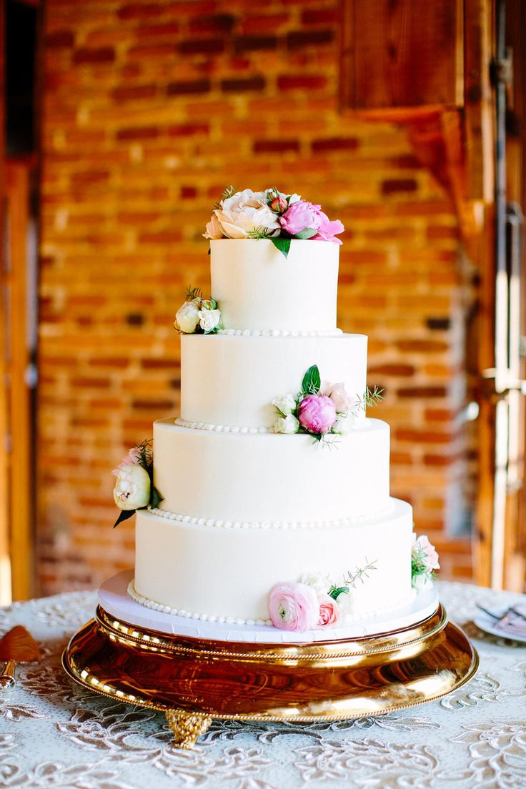 Gold cake stand, ornate & elegant, classic white wedding cake, ranunculus & peony // Anna Routh Photography