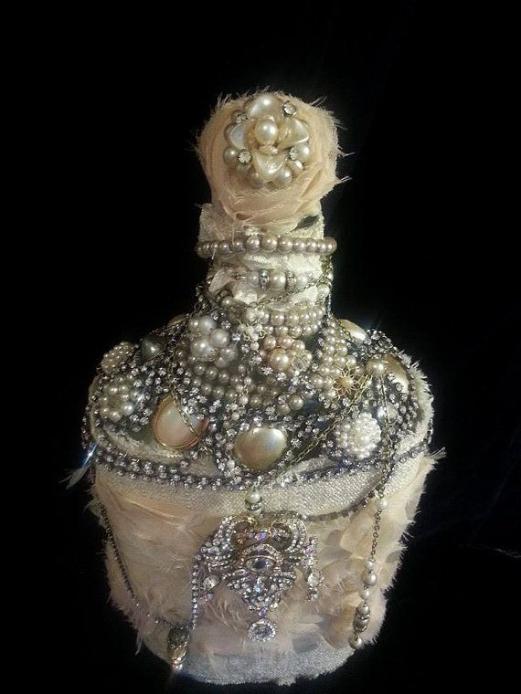 Saw these in person at a show -- LOVE! Going to have to make me a few....  Vintage jewels altered bottle. by glitterandrust1 on Etsy, $125.00