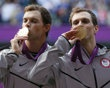 Mike and Bob Bryan of the U.S. kiss their gold medals after defeating France