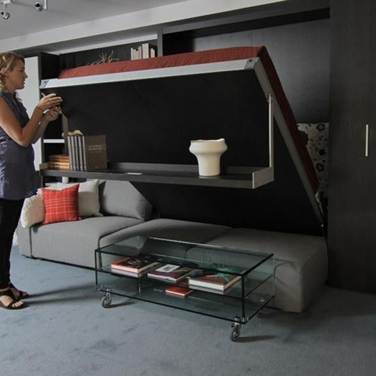 This is the coolest, most functional murphy bed that I've ever seen. I've always thought murphy beds were brilliant, but I know in my heart that I would be too lazy to move my furniture around every night to flip my bed down. Problem solved