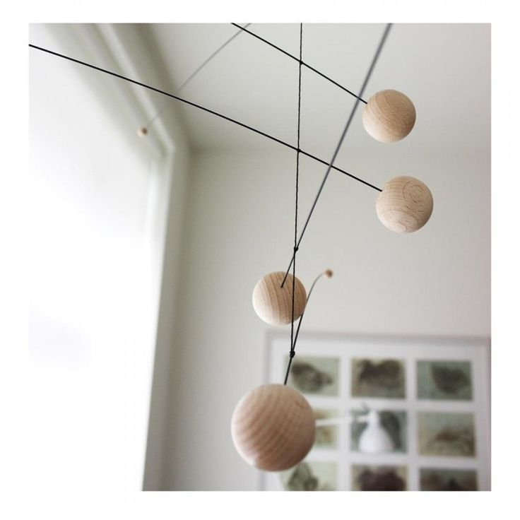 designstuff offers a range of Scandinavian home decor including this stunning wood baby mobile by Flensted Mobiles..