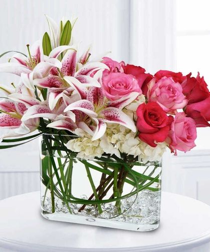 Fragrance of Spring - Delight her senses when you send this fragrant bouquet of pink & red roses, white hydrangea and Stargazer lilies with clear gemstones in the bottom of the vase