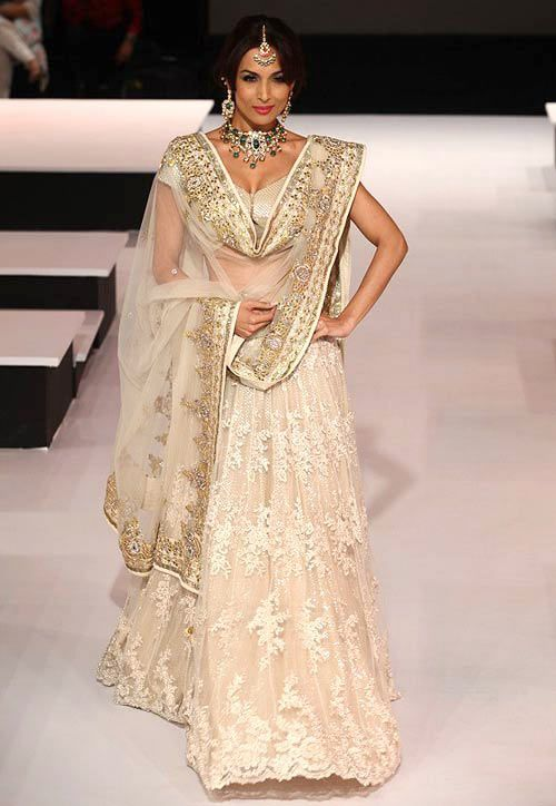 White and good lehenga with intricate detailing.