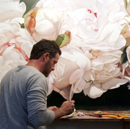 Thomas Darnell (American, b.1958–) at work on one of his huge Peony oil paintings. He moved to Europe in 1992 and lives parttime in the south of France
