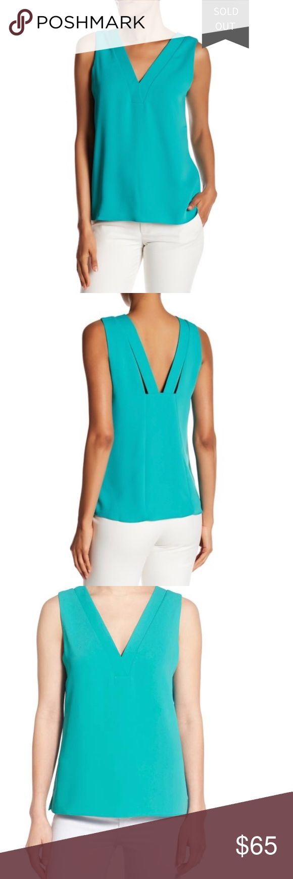 "[Cooper & Ella] Ellie Double V Neck Tank NWT An ultra-flattering matte-crepe tank features sharp V-necklines that flatter in front & behind, plus beautifully modern cutout details that accent the back. Hidden bra snaps secure your straps to ensure a sleek look that never slides out of place. Double V-neck. 100% polyester. Hand wash cold, line dry. True to size Approx. 26"" length (size S) Side slits  Back cut out detail on straps  Model's stats: - Height: 5'11"" - Bust: 34"" - Waist: 24""…"