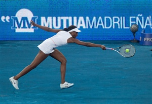 Venus Williams of USA returns the ball to Simona Halep of Romania during the first day of the WTA Mutua Madrilena Madrid Open Tennis on May 5, 2012 in Madrid, Spain.