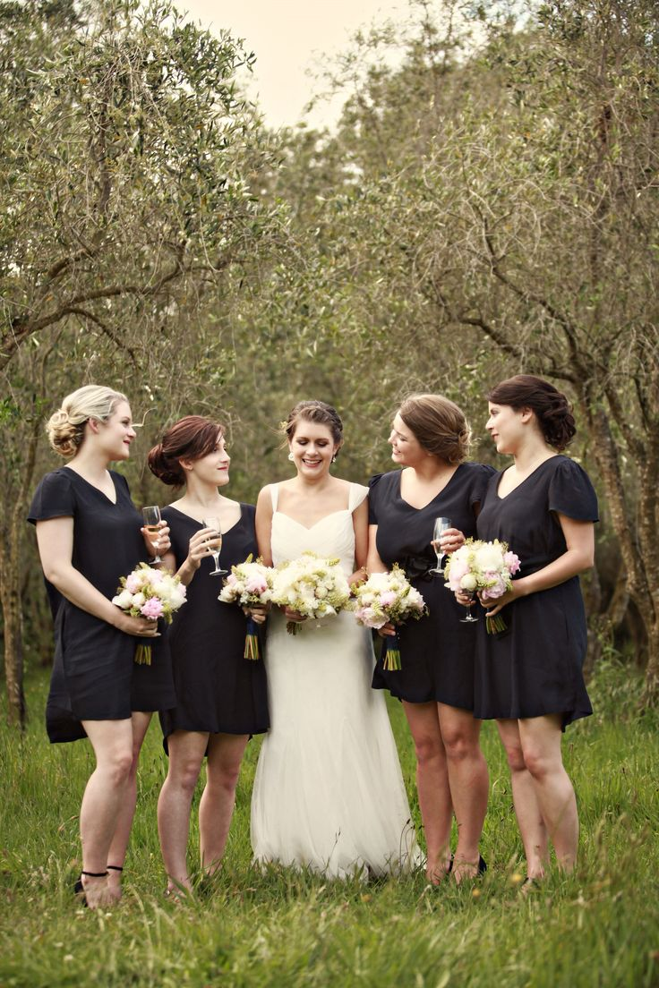 Bride and bridesmaids in short navy blue dresses