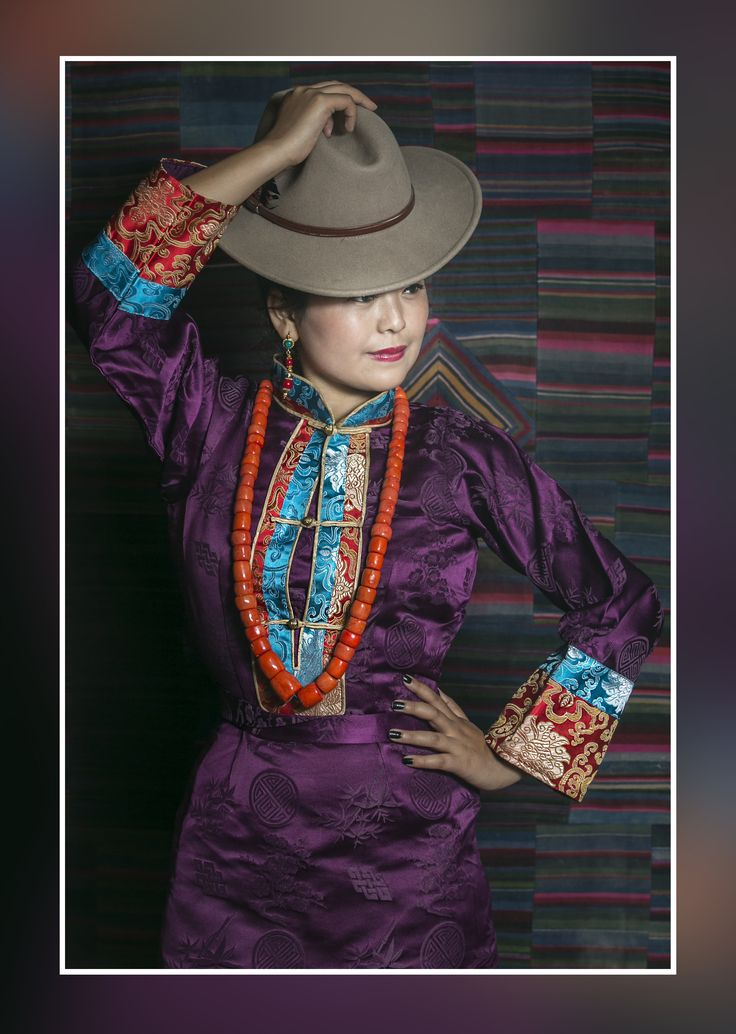Tibetan chupa with hat and background pattern is tibetan pangden (apron)