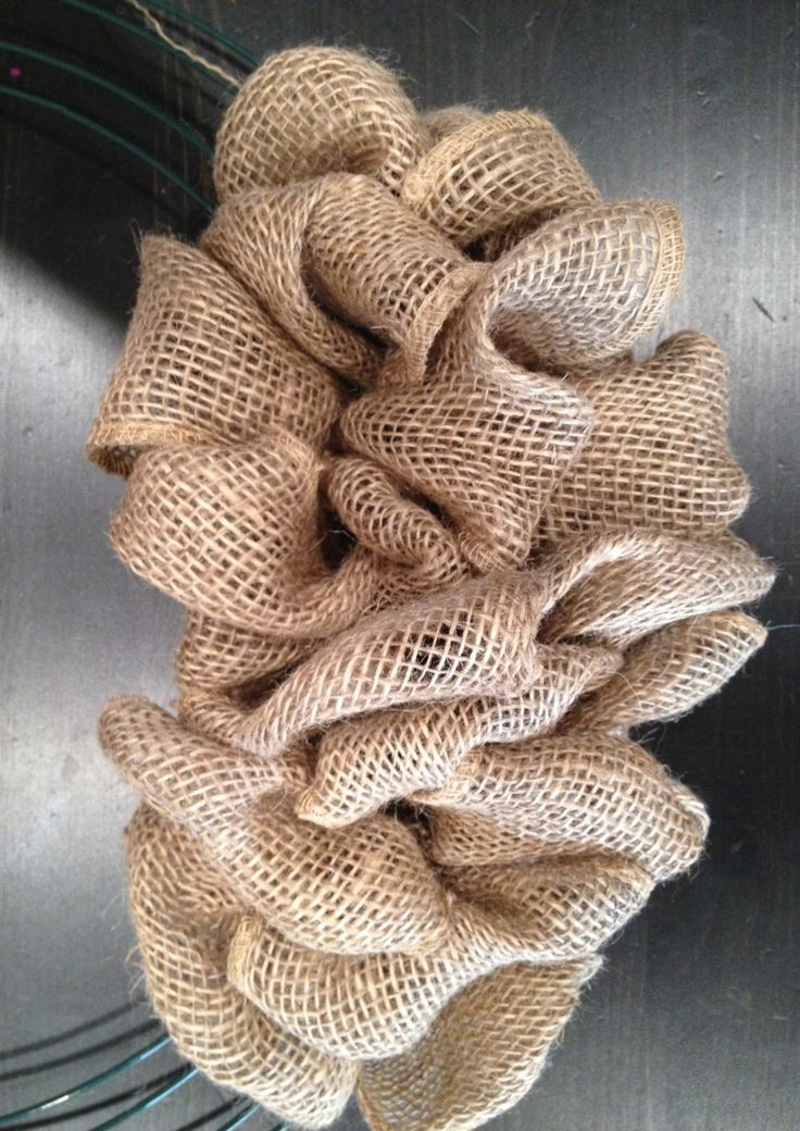 Burlap wreath- You will need: ~ A wire wreath form ~ Burlap ribbon (I used about 2 and a half rolls of 4″ burlap ribbon from Michael's) ~ Floral wire