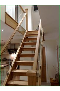 Hunters Barn Glass Staircase - Our customer chose an  American white oak, straight, open tread staircase with glass balustrade and a bullnose feature step,  opting  for a low profile handrail, square newel posts which were completed with pyramid newel caps.