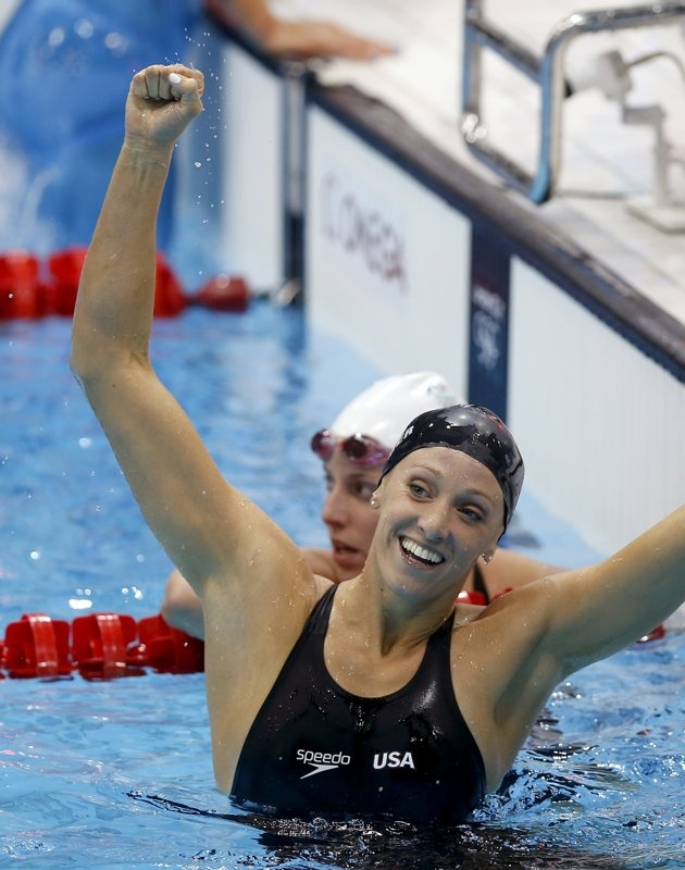 Dana Vollmer sets NEW WORLD RECORD for the 100m Butterfly at 55.98! #GoTeamUSA #USASwimming #LondonOlympics