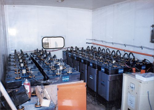 A room full of batteries that are part of a battery bank.