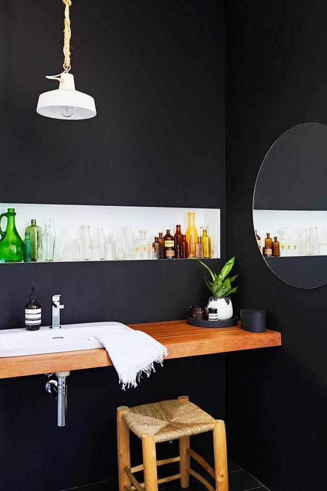 Black bathroom from a renovated workers cottage in Brisbane. Photo: Alicia Taylor | Styling: Jacqueline Kaytar | Story: real living