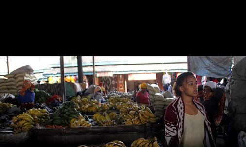 Here is a #rare #photo of Liz #shopping for supplies in Kilombero #market taken by our friend kit Kat. After shopping here for years we can walk around with the freedom not found elsewhere, taking photos and talking to stall holders with easy #relaxation, sampling #fruits, buying #spices by the kilo.