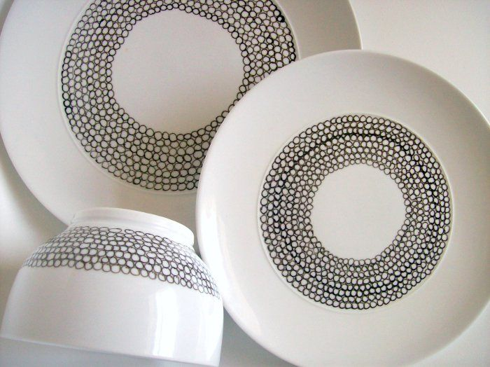Revamp white dishes. Use a porcelain paint pen from  Michael's and draw your design. Once finished, you just bake it at  300 for 35 mins and you're done!