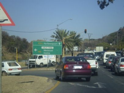 """Gezina, suburb in Pretoria, if you turn left…Pretoria and other destinations if you continue…traffic early morning…10 o'clock-ish."" 2007?"