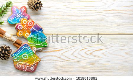 Homemade christmas gingerbread cookies on white wooden background top view with copy space