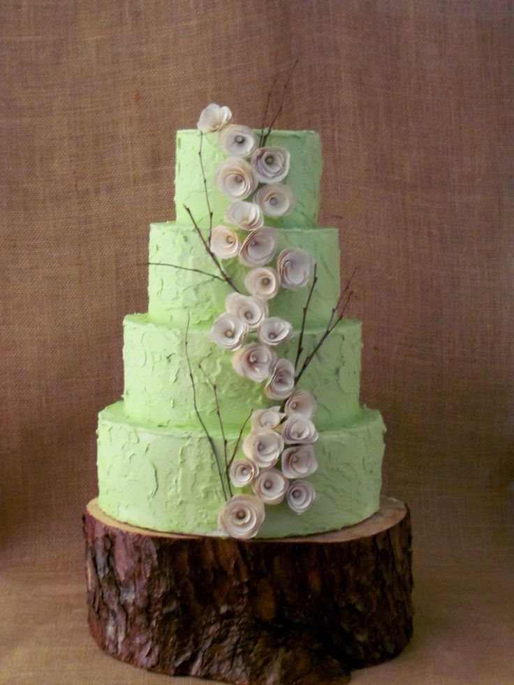 Wooden flowers, willow branches, and textured buttercream icing...this #weddingcake is perfect for a rustic #wedding!  From http://rusticweddingchic.com/rustic-wedding-inspiration-board  Cake and Photo Credit: http://thetwistedsifter.com/