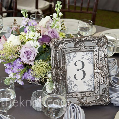 Small and stylish wedding floral centerpieces and vintage frame for table number