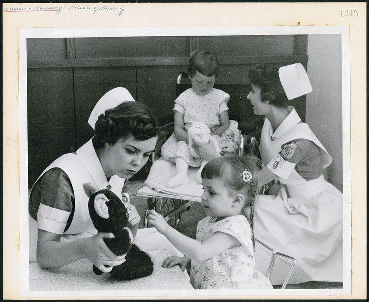 Two student nurses amusing young patients at the Children's Hospital school of nursing in Winnipeg / Deux infirmières étudiantes amusant de jeunes patients à l'école d'infirmières du Children's Hospital à Winnipeg | by BiblioArchives / LibraryArchives