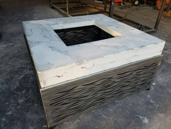 Custom concrete fire feature from Chicago steel artist Tim Hawley