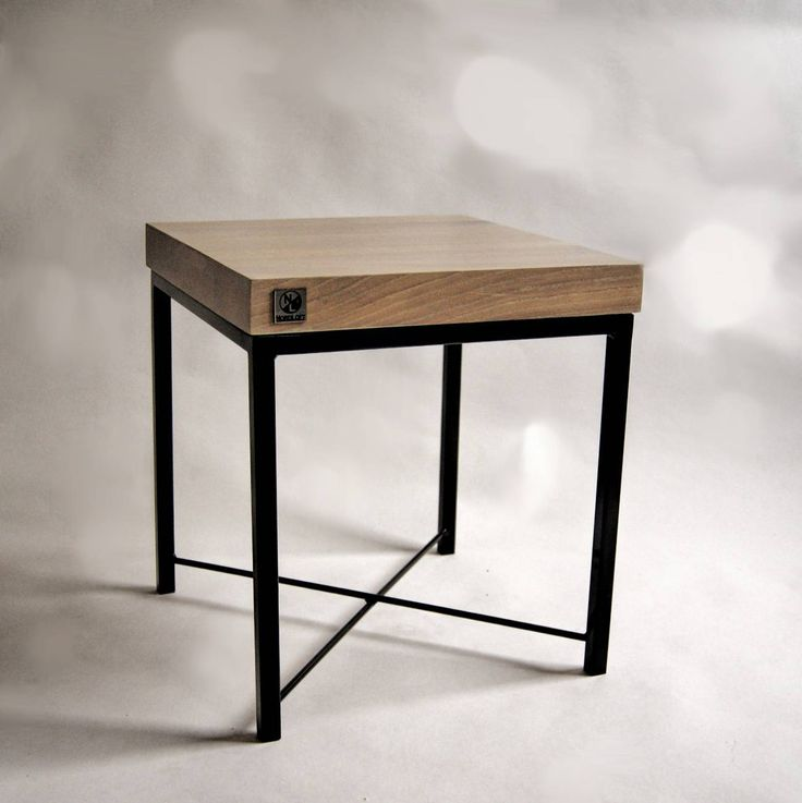Thick (5 cm) solid oak tabletop mounted on a soft but stable steel structure. Due to the small size this table is perfect as a side or a display table.