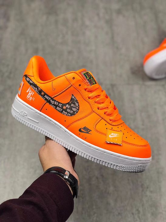 72e052376bd90 NIKE AIR FORCE 1 LOW JUST DO IT LOGO PRINT ORANGE 905345 800  womenswear