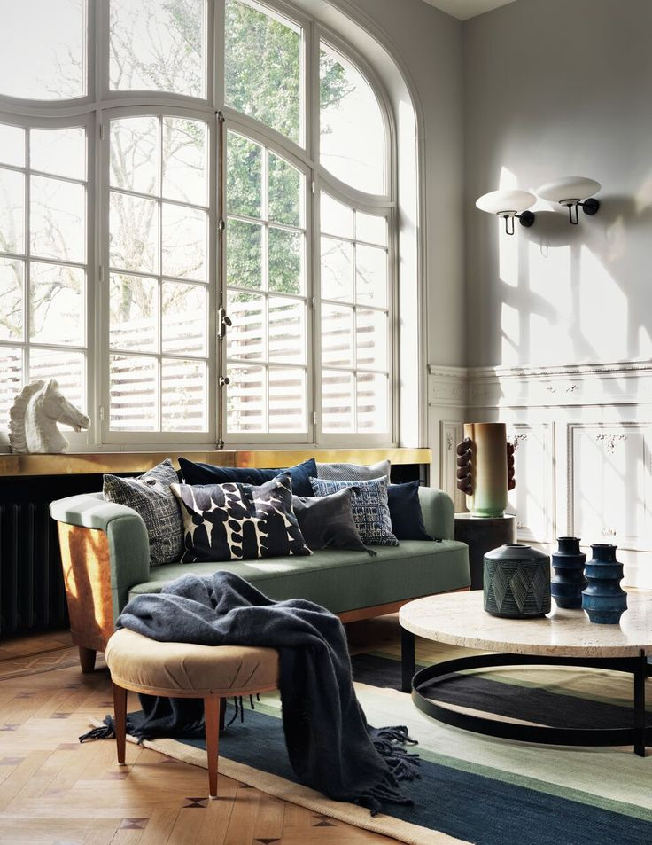 Linum textiles campaign styled by Dusty Deco - Living room, green sofa, textiles, ceramics, big window apartment, vintage..