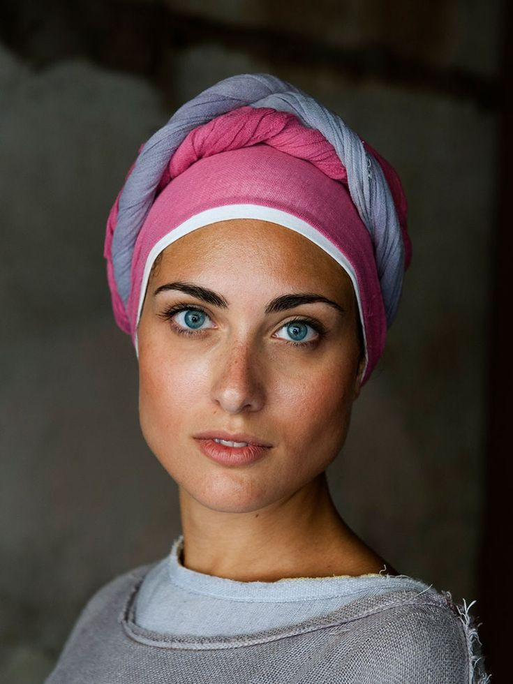 (Umbria, Italy | Steve McCurry) The colour palette of this image comes together perfectly, allowing it's focus to be on the natural beauty that the woman holds.