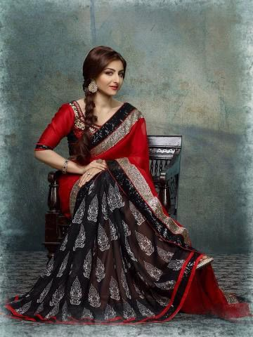 Exclusively designed, this beautiful black & red combination  saree will enhance your curves and  will keep you comfortable. In this saree there is red georgette pallu with black printed skirt  will surely fetch you compliments for your rich sense of style.