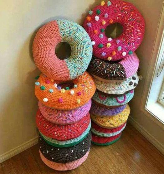 These donut pillows look good enough to eat! Their fun and bright colors would be a welcome addition to any home.