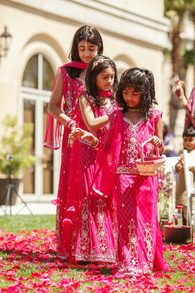Adorable little flower girls in striking pink ensembles at an Indian real wedding. Click to see more! {Nadia D Photo}