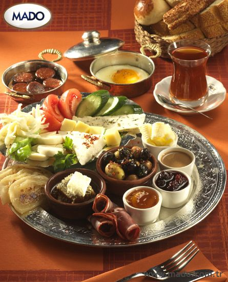 Typical Turkish breakfast.... several types of cheese, olives, bread, tomatoes, cucumber, turkish sausage, comb honey, jam and CAY (tea)