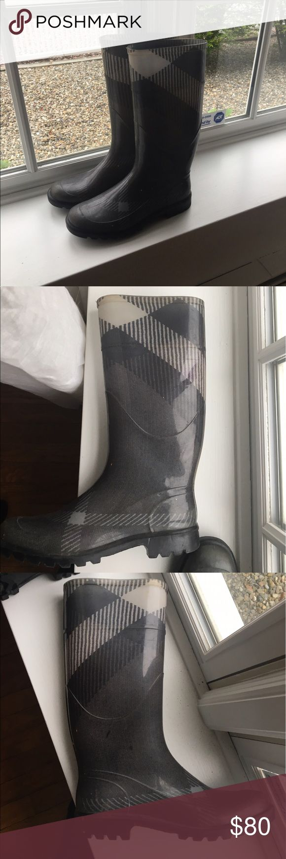 Burberry Wellington Rain Boots Burberry Wellington Boots in grey. These boots have been worn a few times. Some discoloration on the white and some black scuff marks. I do not have the box anymore :/. Will provide additional pics if necessary Burberry Shoes Winter & Rain Boots