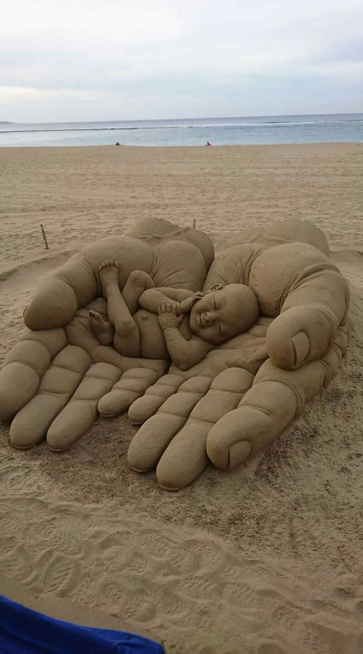 HE'S got the whole world in HIS hands! Beautiful sand art!