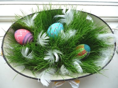 handpainted Easter eggs tucked away in Finnish Easter grass