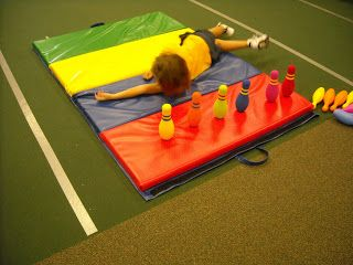 Log roll bowling will help increase proprioceptive awareness. Rolling and crashing into the pins will provide the child with proprioceptive input and help him/her feel his/her body parts in space.