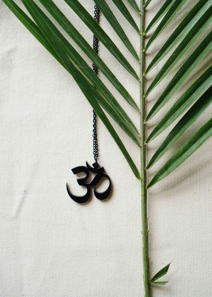 OM necklace, made out of black acrylic. Brand; Ubuntu-Wear.