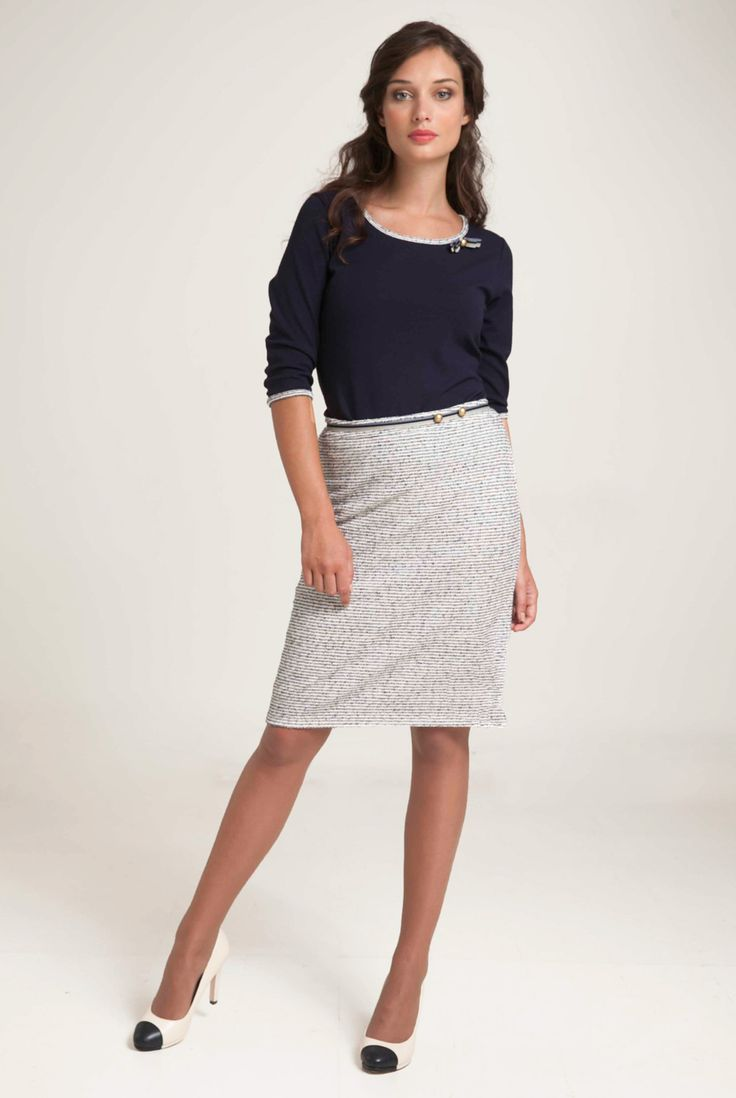 """One color top with """"round"""" neck and three quarter sleeves. Contrast tweed edgings at neckline. Removable bow trimmed with golden button. Combine with tweed skirt for total outfit. http://www.alexanderjacob.com/en/tops-blouses/194-contrast-tweed-detail.html"""
