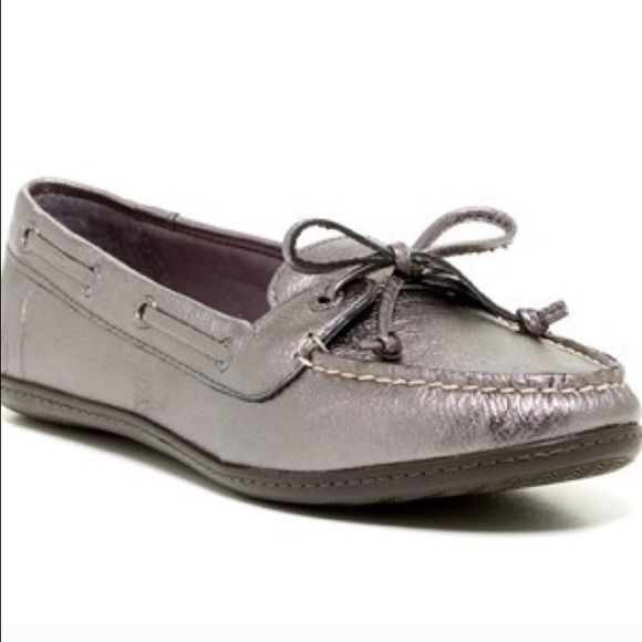 Sperry Top Sider So cute and comfortable! These Sperry Top Siders are slip on and Pewter Metallic in color! Leather upper with man made soles. Sperry Top-Sider Shoes