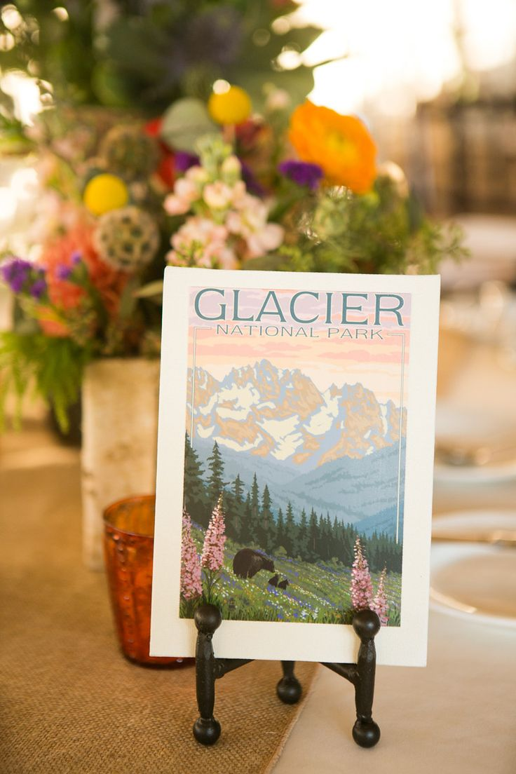 Yosemite Wedding: Every table was named for a national park. Vintage national park post cards on canvas  - brentvanaukenphotography