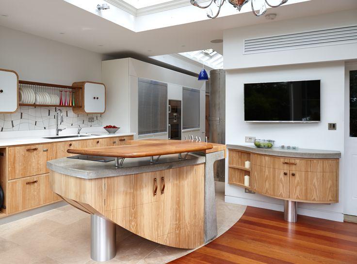 Concrete base and polished concrete top. Designer Johnny Grey