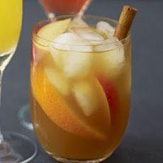 Winter Pimm's punch Recipe Beverages with brandy, apple juice, ice, cinnamon sticks, apples, orange