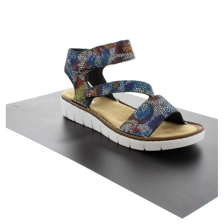 Rieker 60012-90 Multicoloured/Metallic sandal.  a wardrobe must-have. In multi coloured suede leather, the stylish shoes feature a slight heel making them perfect for wearing during the day or on an evening. They include a velcro ankle strap for added comfort, which also makes them secure.