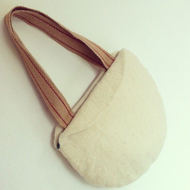 Wool-a-bag with burlap handles.